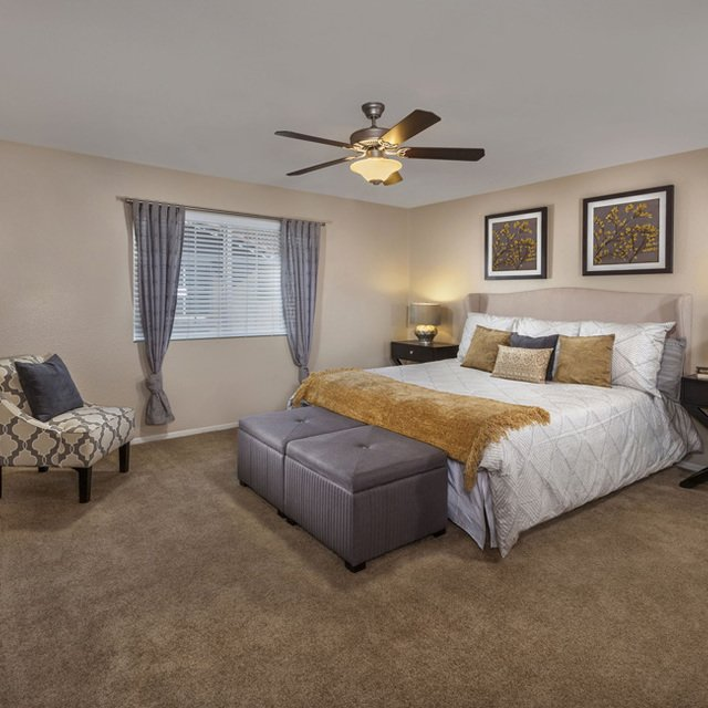 Homecoming at Eastvale Apartments - Bedroom with white sheets
