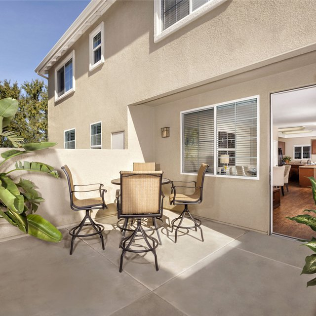 Homecoming at Eastvale Apartments - Home patio