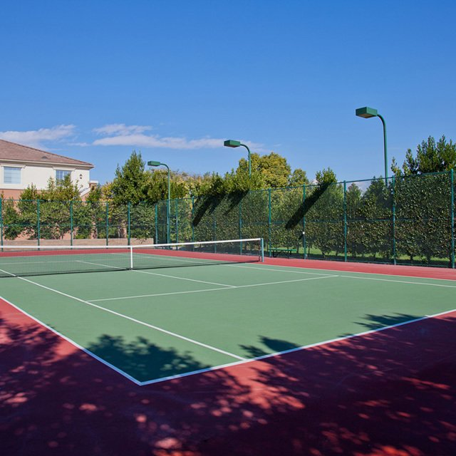 Homecoming at Eastvale Apartments - Tennis courts