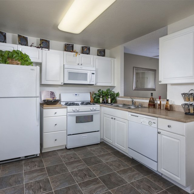 Terra Vista Apartments - Kitchen with White Cabinetry