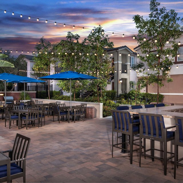 Homecoming at the Preserve Apartments - Outdoor patio at night