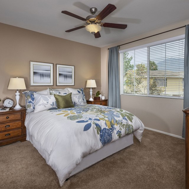 Homecoming at Terra Vista Apartments - Bedroom with white sheets