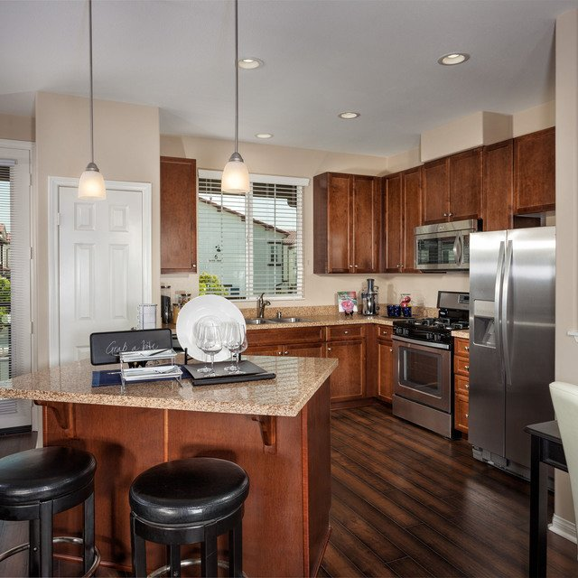 The Enclave at Homecoming Terra Vista - Kitchen with wood flooring