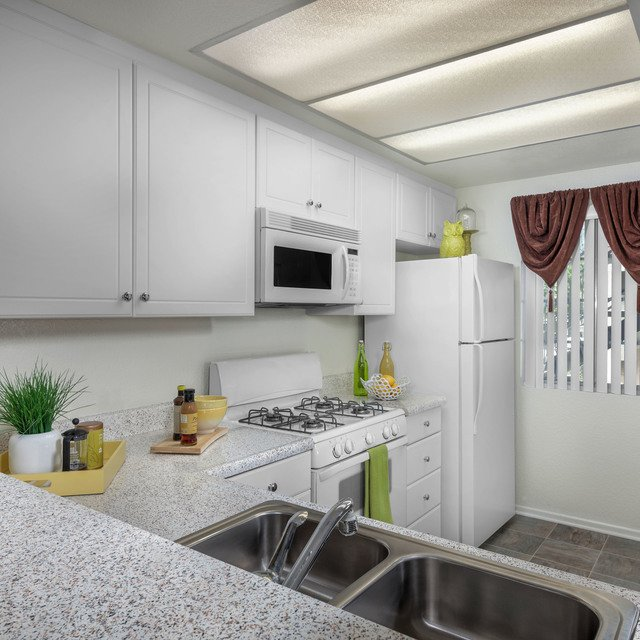 Green Valley Apartments - Kitchen and sink