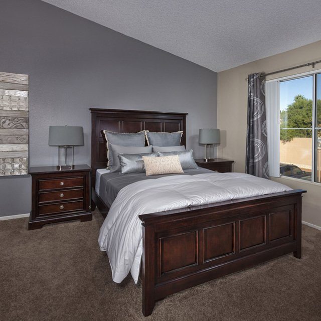 Crystal Cove Apartments - Bedroom with grey sheets