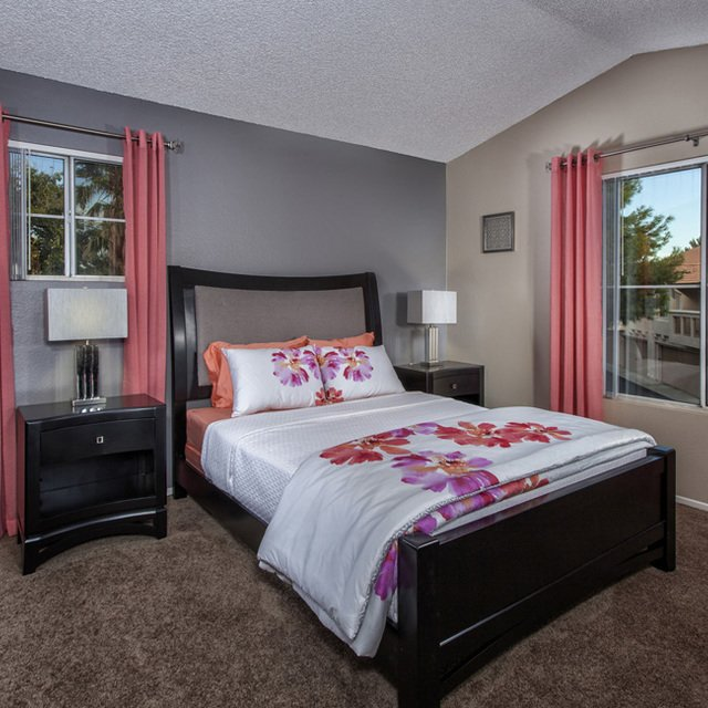 Crystal Cove Apartments - Bedroom with white sheets
