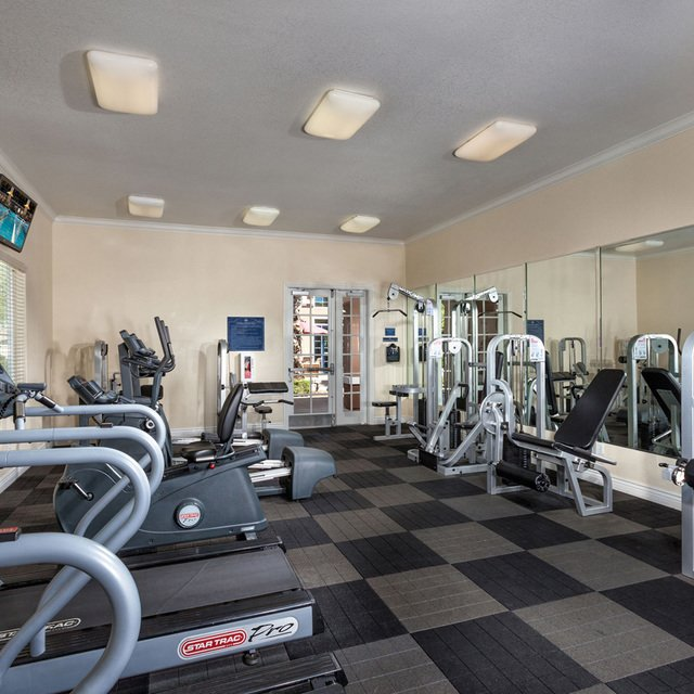 Carmel at Woodcreek West Apartments - Fitness center with treadmills