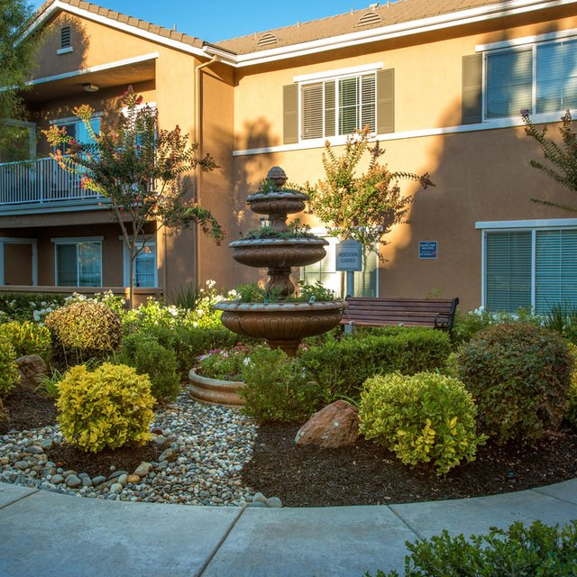 Carmel at Woodcreek West Apartments - Walkway and fountain
