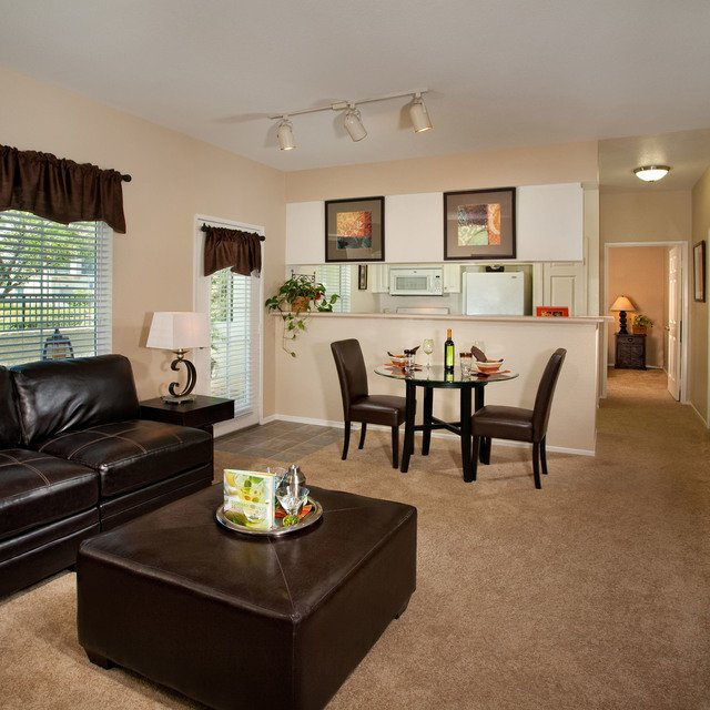 Del Mar Apartments - Living area with black couch