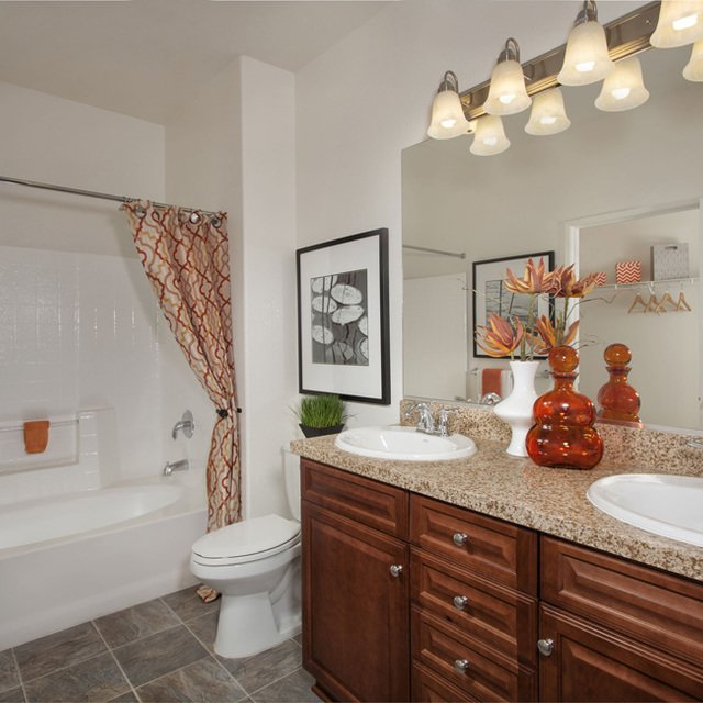 Carmel at Terra VIsta | Bathroom with red flowers