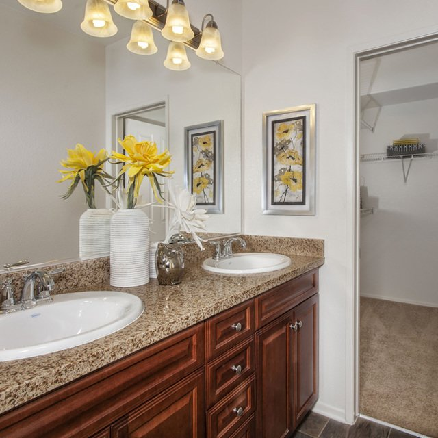 Carmel at Terra VIsta | Bathroom with yellow flowers