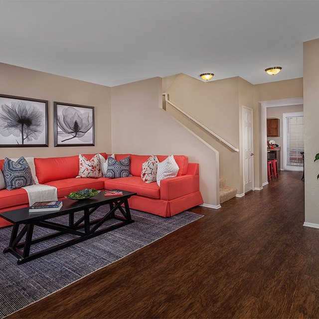 Homecoming at Eastvale Apartments - Living area with plants