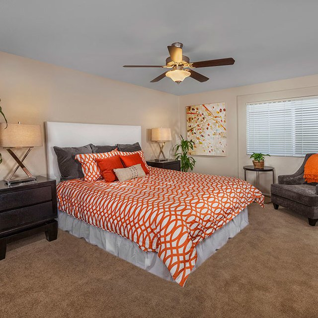 Homecoming at Eastvale Apartments - Bedroom with loveseat