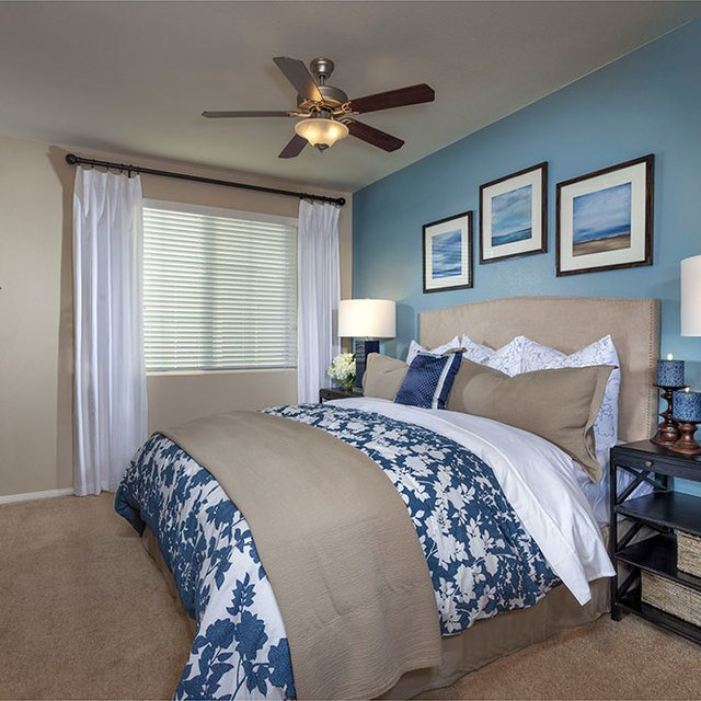 Homecoming at the Preserve Apartments - Bedroom with blue sheets