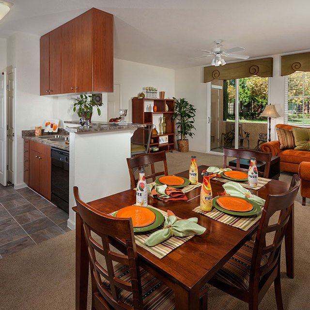 Homecoming at Creekside Apartments - Dining table and living room