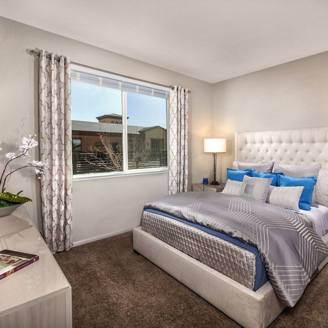 Harvest at Damonte Ranch Apartments - Bedroom with grey sheets
