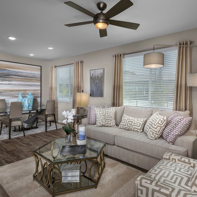 Harvest at Damonte Ranch Apartments - Living room with glass coffee table