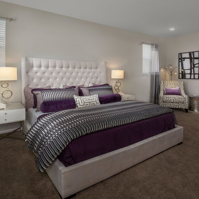 Harvest at Damonte Ranch Apartments - Bedroom with purple sheets