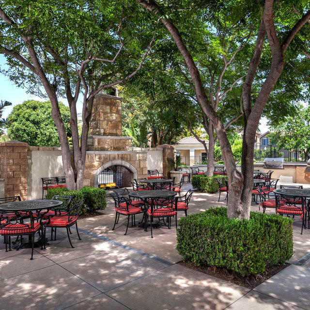 Homecoming at Eastvale Apartments - Outdoor patio and trees