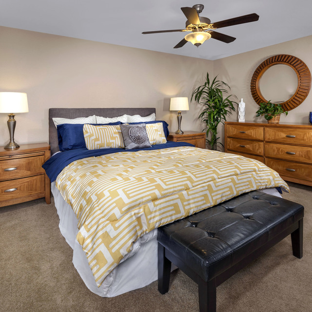 Homecoming at Eastvale Apartments - Bedroom with wood drawers